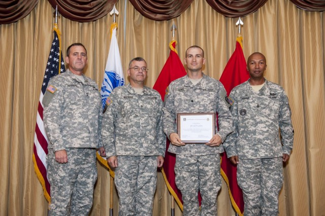 Spc. Keith Lewis, representing the Army Reserve Medical Command, placed runner up in the junior enlisted category in the 2014 Army Reserve Best Warrior Competition during the award ceremony at Joint Base McGuire-Dix-Lakehurst, N.J., June 27. From left: Maj. Gen. Glenn Lesniak, deputy commanding general of the Army Reserve; Brig. Gen. Ferdinand Irizarry, deputy chief of staff of the Army Reserve; Lewis, from Fresno, Calif.; and Command Sgt. Maj. Luther Thomas, command sergeant major of the Army Reserve. (U.S. Army photo by Sgt. 1st Class Michel Sauret)