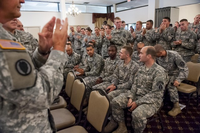 Soldiers and Army Reserve leaders give a standing ovation to the contestants and winners of the 2014 Army Reserve Best Warrior Competition during the award ceremony at Joint Base McGuire-Dix-Lakehurst, N.J., June 27. (U.S. Army photo by Sgt. 1st Class Michel Sauret)