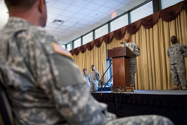 Command Sgt. Maj. Luther Thomas, command sergeant major of the Army Reserve, congratulates the contestants and winners of the 2014 Army Reserve Best Warrior Competition on their hard work throughout the competition during the award ceremony at Joint Base McGuire-Dix-Lakehurst, N.J., June 27. (U.S. Army photo by Sgt. 1st Class Michel Sauret)