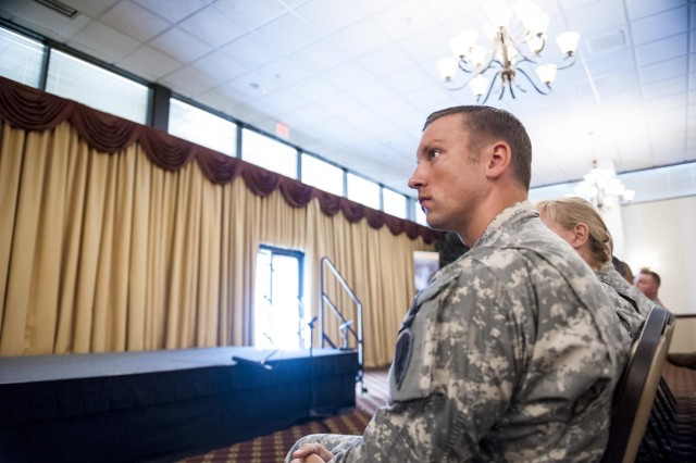 Sgt. 1st Class Jason Manella, with the 445th Civil Affairs Battalion, of Fremont, Calif., and the 2013 Noncommissioned Officer of the Year, listens to remarks made during the 2014 Army Reserve Best Warrior Competition award ceremony at Joint Base McGuire-Dix-Lakehurst, N.J., June 27. (U.S. Army photo by Sgt. 1st Class Michel Sauret)