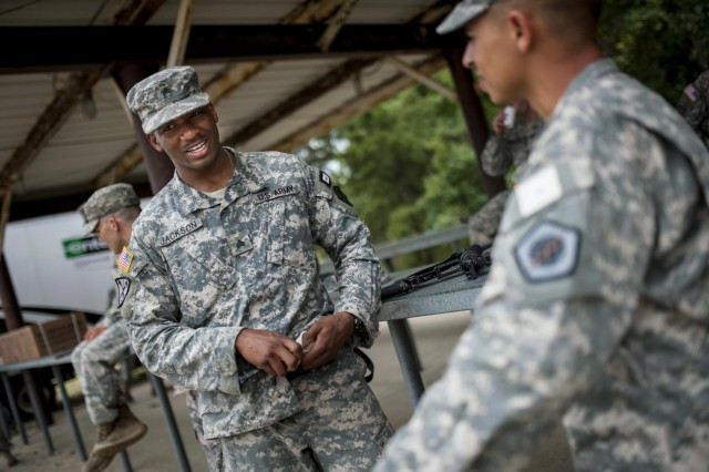 Sgt. Juan Jackson, an internment specialist from Lakewood, Wash., with the 493rd Military Police Company, jokes around with Soldiers during the 2014 Army Reserve Best Warrior Competition at Joint Base McGuire-Dix-Lakehurst, N.J., June 25. (U.S. Army photo by Sgt. 1st Class Michel Sauret)