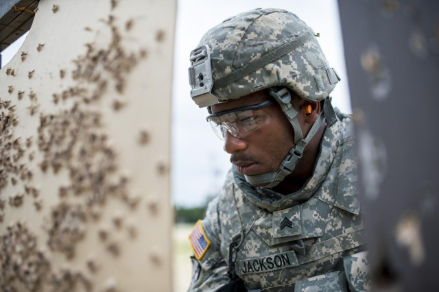 Sgt. Juan Jackson, an internment specialist from Lakewood, Wash., with the 493rd Military Police Company, inspects his shot group on the M16 zero range during the 2014 Army Reserve Best Warrior Competition at Joint Base McGuire-Dix-Lakehurst, N.J., June 25. (U.S. Army photo by Sgt. 1st Class Michel Sauret)