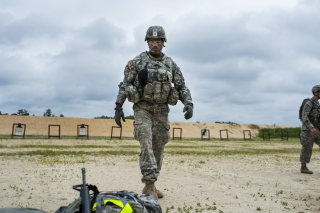 Sgt. Juan Jackson, an internment specialist from Lakewood, Wash., with the 493rd Military Police Company, walks back to his weapon after inspecting his target on the M16 zero range during the 2014 Army Reserve Best Warrior Competition at Joint Base McGuire-Dix-Lakehurst, N.J., June 25. (U.S. Army photo by Sgt. 1st Class Michel Sauret)