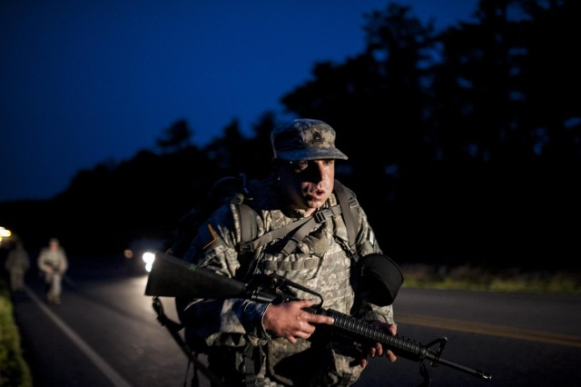 Sgt. 1st Class Timothy Kearns, combat engineer and trainer with the 75th Training Division, living in Houston, conducts an early morning road march that spanned eight miles while carrying a 35-pound ruck and a rifle during the 2014 Army Reserve Best Warrior Competition at Joint Base McGuire-Dix-Lakehurst, N.J., June 25. (U.S. Army photo by Sgt. 1st Class Michel Sauret)