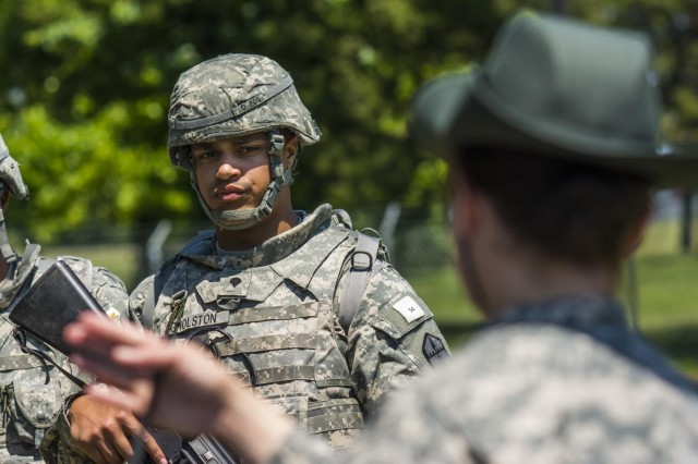 Spc. Rahmad Gholston, resident of Pullman Wash. and an air defense artillery specialist with the 301st Maneuver Enhancement Brigade, evaluates a dummy representing a casualty to see which first aid interventions are needed during the 2014 Army Reserve Best Warrior Competition at Joint Base McGuire-Dix-Lakehurst, N.J., June 24. (U.S. Army photo by Sgt. 1st Class Michel Sauret)