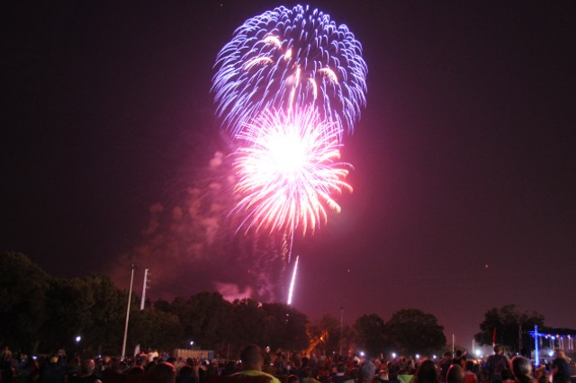 Fireworks explode above the festival fields on Fort Rucker as the crowd watches on during the 2014 Wiregrass Freedom Fest July 3.