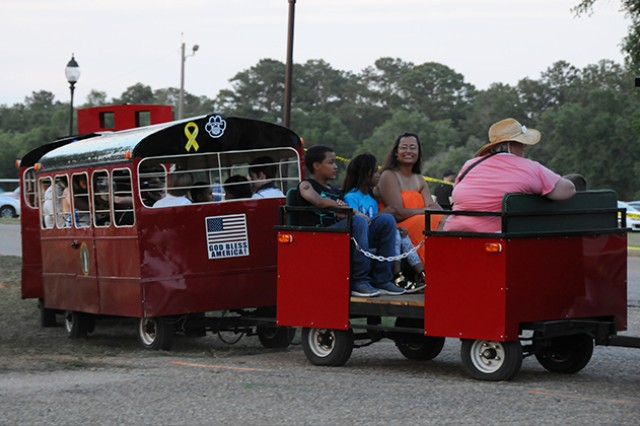 Families take a ride on the train around the festival fields June 3.