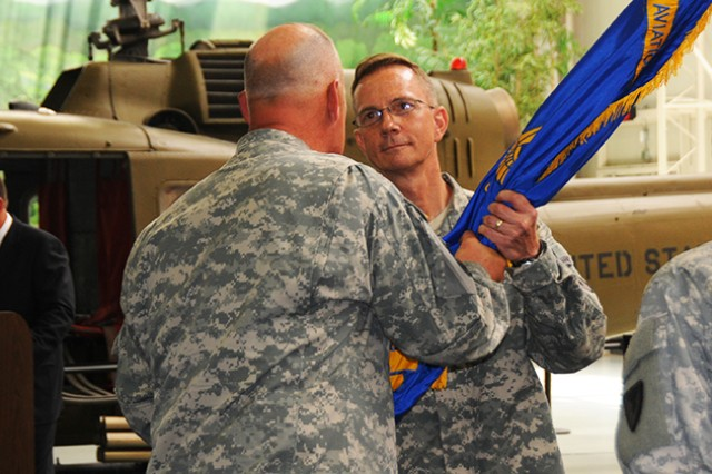 Col. Kenneth Kliethermes, U.S. Army Aviation Center Logistics Command, receives the unit colors from Maj. Gen. James M. Richardson, U.S. Army Aviation and Missile Life Cycle Management Command commanding general, during a change of command ceremony where he assumed command from Col. Michael Aid at the U.S. Army Aviation Museum July 1.