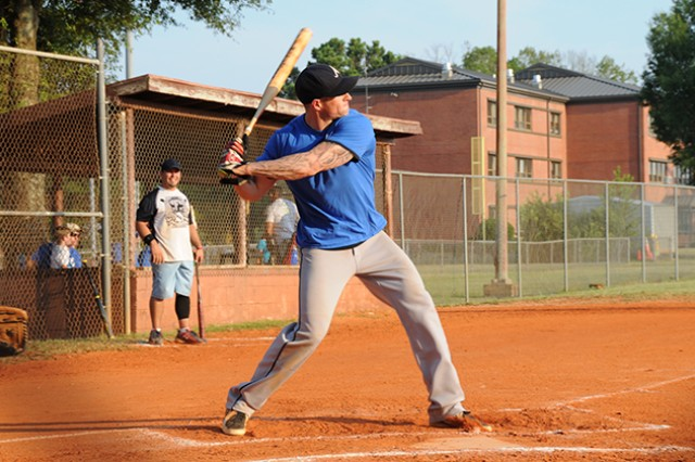 Matt Rendel, player for the Outcasts takes a swing during his team's final Fort Rucker Intramural Softball regular season game against Plug Uglies July 8.