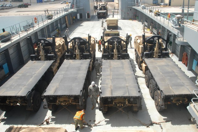 Army mariners from the 163rd Transportation Detachment and their U.S. Navy counterparts load 15 vehicles directly from the shore onto Logistic Support Vessel-2, the U.S. Army Vessel CW3 Harold C. Clinger, during Combined Joint Logistics Over the Shore operations on Ford Island, Hawaii, July 11, 2014, as part of exercise Rim of the Pacific 2014. The logistics support vessel has both bow and stern ramps for roll-on and roll-off operations, and can beach itself to load or discharge cargo over the shore in as little as four feet of water.