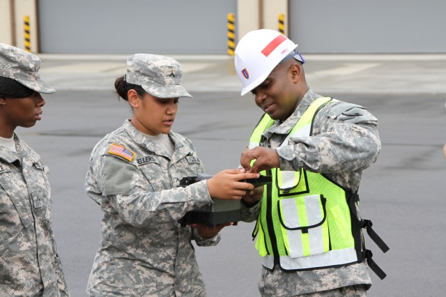 Staff Sgt. Christopher S. Rutley, the noncommissioned officer in charge for outside plans, 501st Signal Company, 36th Signal Battalion, 1st Signal Brigade, shows Pvt. Hepuaona Lani Keali'i Kane Sellers, a cable system installer and maintainer, Charlie Company, 304th ESB, 1st Signal Brigade, how to use the fiber optics testing equipment during the fiber university training at Camp Humphreys, South Korea July 9, 2014. (U.S. Army Photo by Capt. Traun C. Moore)