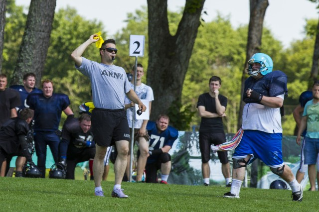 Spc. Tirce Opie, a supply clerk with 1st Squadron, 91st Cavalry Regiment, 173rd Airborne Brigade, throws a flag on a play during an amateur league American football game between the Riga Lions from Latvia, and the Tartu Titans from Estonia, in Upesciems, Latvia, July 5, 2014. Opie, a native of Tallahassee, Fla., served as a referee with two other paratroopers from the 173rd Abn. Bde. Approximately 600 paratroopers from the brigade are in Estonia, Latvia, Lithuania and Poland as part of Operation Atlantic Resolve, an unscheduled land-forces exercise to demonstrate commitment to NATO obligations and sustain interoperability with allied forces.