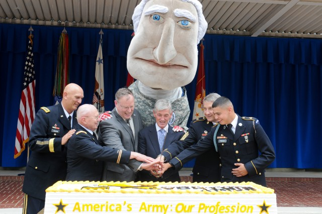 Representing the oldest Soldier in the Military District of Washington, Col. Arthur Wittich second from left, takes part in the annual Army birthday cake-cutting at the Pentagon, June 19, 2014. Pictured left to right are Army Chief of Staff Gen. Ray Odierno; Wittich; Deputy Secretary of Defense Robert O. Work; Secretary of the Army John McHugh; Sgt. Maj. of the Army Raymond F. Chandler III; and Pvt. Christoper French, the youngest Soldier in the MDW.