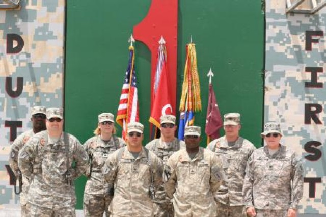 Col. Arthur Wittich (far right), then a 1st Infantry Division surgeon with the 1st Combat Aviation Brigade, poses with flight medics assigned to Company C, 2nd General Support Aviation Battalion, 1st Aviation Regiment, who received the Combat Medic Badge, at Contingency Operating Base Speicher, Iraq, July 28, 2008.
