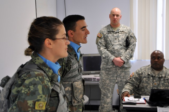 Albanian 2nd Lt. Hekuran Budani and Sgt. Marjana Kotarja speak to students of the Command and General Staff Officer Course at Joint Base Dix-McGuire-Lakehurst, N.J., about the first-of-its-kind Officer Candidate School they are attending. In the background is Matthew Zilinski, senior platoon training officer of New Jersey's OCS program for the Albanians.