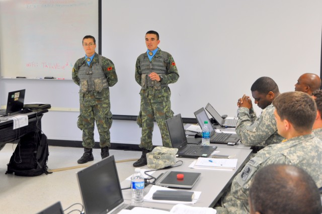 Albanian 2nd Lt. Hekuran Budani and Sgt. Marjana Kotarja speak to students of the Command and General Staff Officer Course at Joint Base Dix-McGuire-Lakehurst, N.J., about the Officer Candidate School that the New Jersey National Guard is hosting for Albanians.