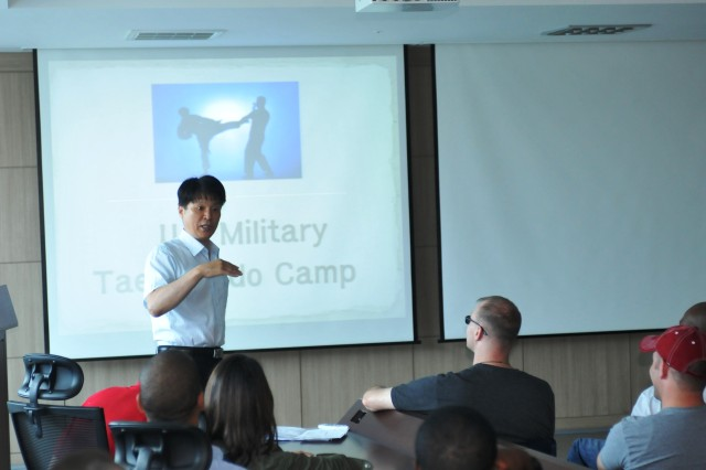 YONGSAN, South Korea -- Soldiers listen to a lecture about the history and basic concepts of Taekwondo during a Taekwondo camp held by the Ministry of National Defense June 10, in Yongsan, South Korea.. (U.S. Army photo by Pfc. Song Gun-woo, 210 FA BDE PAO)