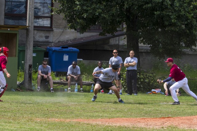 Pfc. Derek Freda, a native of Phoenix, finds himself caught in a rundown between third base and home plate during a friendly game between paratroopers with 1st Squadron, 91st Cavalry Regiment, 173rd Airborne Brigade, and the Latvian national baseball team, in Riga, Latvia, July 12, 2014. Approximately 600 paratroopers from the brigade are in Estonia, Latvia, Lithuania and Poland in support of Operation Atlantic Resolve to demonstrate commitment to NATO obligations and sustain interoperability with allied forces.