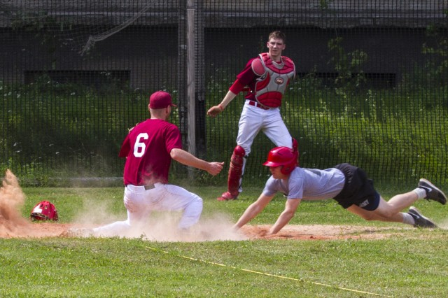 Spc. Vincent Murray, a native of Akron, Ohio, dives toward home plate during a friendly game between paratroopers with 1st Squadron, 91st Cavalry Regiment, 173rd Airborne Brigade, and the Latvian national baseball team, in Riga, Latvia, July 12, 2014. Approximately 600 paratroopers from the brigade are in Estonia, Latvia, Lithuania and Poland in support of Operation Atlantic Resolve to demonstrate commitment to NATO obligations and sustain interoperability with allied forces.