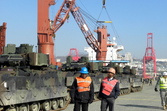 M2A3 and M3A3 Bradley Fighting Vehicles discharged from the Ocean Titan are staged at the Port of Busan, January 2014. Troops and equipment from the 1st Battalion, 12th Cavalry Regiment from Fort Hood and the 4th Attack Reconnaissance Squadron, 6th Cavalry Regiment from Joint Base Lewis-McChord were deployed to the Korean Theater of Operations in support of the U.S. defense commitment to the Republic of Korea (ROK), and the 403rd AFSB partnered with 8th Army, the 2nd Infantry Division and the 19th Expeditionary Sustainment Command to support the effort.