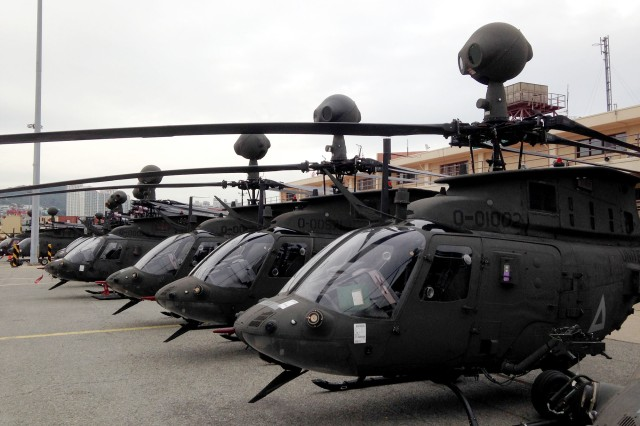 OH-58D Kiowa Warrior helicopters discharged from the Ocean Giant are staged at Pier 8, Port of Busan, January 2014, part of rotational unit training in the ROK.