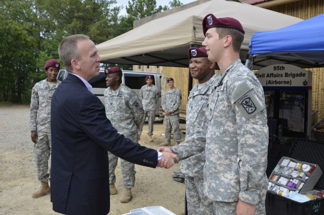 FORT BRAGG, N.C. -- Under Secretary of the Army, Hon. Brad Carson, meets with Soldiers from the 95th Civil Affairs Brigade (Airborne) during his visit with USASOC on Fort Bragg, July 15, 2014. Hon. Carson, observed capabilities displays from the units within USASOC at Range 37, introducing Army Special Operations Forces capabilities and operations.