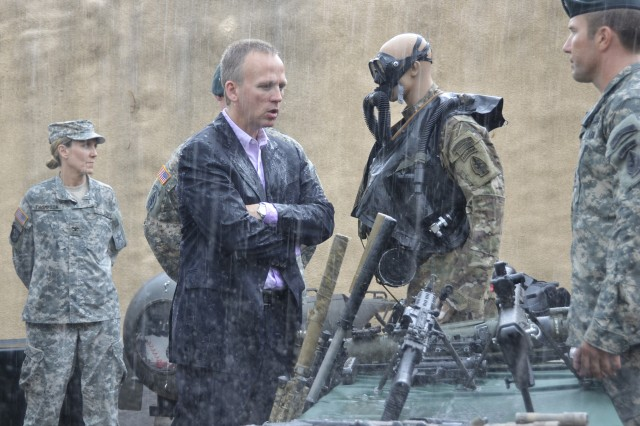 FORT BRAGG, N.C. -- The Under Secretary of the Army, Hon. Brad Carson, discusses weapons systems with a Special Forces Soldier during a walkthrough on Range 37, Fort Bragg. Hon. Carson met with USASOC Soldiers to gain firsthand knowledge of Army Special Operations Forces and their capabilities.
