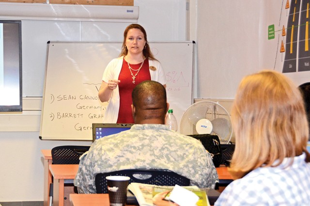 Stephanie Talcott, accredited financial counselor, answers Soldiers' and family members' questions during the Veterans Affairs Home Loans Guarantee Seminar, July 11, 2014, at the Wiesbaden Education Center in Germany.