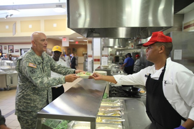 "Gen. Raymond T. Odierno, chief of Staff of the Army, receives his chicken con asparagus, July 14, 2014, from Sgt. Bruce Stiles, a native of Memphis, Tenn., at the 4th Infantry Brigade Combat Team dining facility, at Fort Stewart, Ga.  Odierno toured the Vanguard compound during his visit to Fort Stewart, including the gym, the dining facility and the ""Vanguard"" headquarters building."
