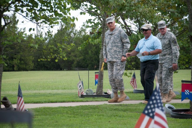 Chief of Staff of the Army Gen. Raymond T. Odierno walks among the Eastern Redbud trees of the Warriors Walk, at Fort Stewart, Ga., July 17, 2014, with Jeff Fornshell, operations specialist ceremonies planning officer, and 3rd Infantry Division Command Maj. Gen. John M. Murray.