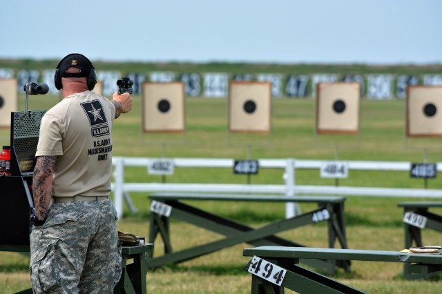 Staff Sgt. Patrick Franks, with the U.S. Army Marksmanship Unit Service Pistol Section, fires during the .45 caliber team match, at Camp Perry, Ohio, July 12, 2014. The USAMU Blue came back from a six-point deficit to win the 2014 National Pistol Team match.
