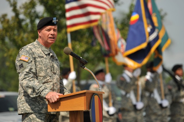Gen. David G. Perkins, commanding general of U.S. Army Training and Doctrine Command, gives opening remarks during TRADOC's Army Capabilities Integration Center assumption of responsibility ceremony at Fort Eustis, Va., July 15, 2014.  Perkins welcomed Lt. Gen. H. R. McMaster, ARCIC incoming director, and Sgt. Maj. Joe B. Parson, incoming command sergeant major. (U.S Air Force photo by Staff Sgt. Katie Gar Ward)