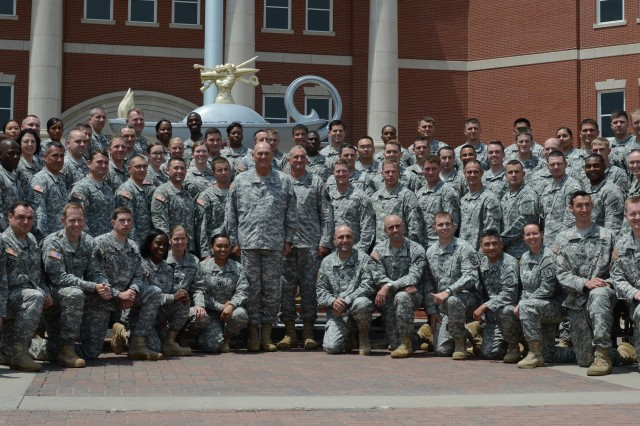 Chief of Staff of the Army Gen. Ray Odierno poses for a photo with some 100 captains at the conclusion of Solarium 2014, July 11, 2014, at the Lewis and Clark Center on Fort Leavenworth, Kan.