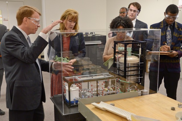 ECBC Technical Director Joseph Wienand (left) explains how 3-D printing allowed researchers to rapidly develop the Field Deployable Hydrolysis System, a new weapons of mass destruction-elimination technology developed to destroy chemical agents.