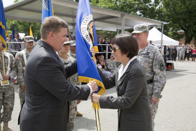 PICATINNY ARSENAL, N.J. - Heidi Shyu, Assistant Secretary of the Army (Acquisition, Logistics and Technology) transfers the guidon for the Program Executive Office for Ammunition to James Shields during a ceremony here yesterday.  The passing of the guidon is symbolic of the orderly transfer of authority from one commander to another.
