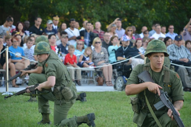 Soldiers from the 3rd U.S. Infantry Regiment (The Old Guard) perform during U.S. Army Military District of Washington's Twilight Tattoo on Whipple Field, Joint Base Myer- Henderson Hall, Va., July 16, 2014.
