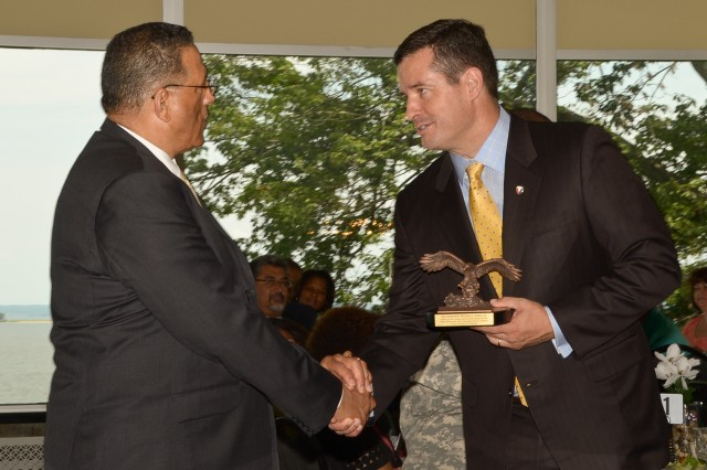 Dale A. Ormond (right), director of the U.S. Army Research, Development and Engineering Command, presents keynote speaker Mike A. Battle Sr., senior adviser to the U.S. Department of State's African Bureau and retired U.S. Army Reserve chaplain, with a gift of appreciation July 16 during the Community Prayer Luncheon at Aberdeen Proving Ground, Md.