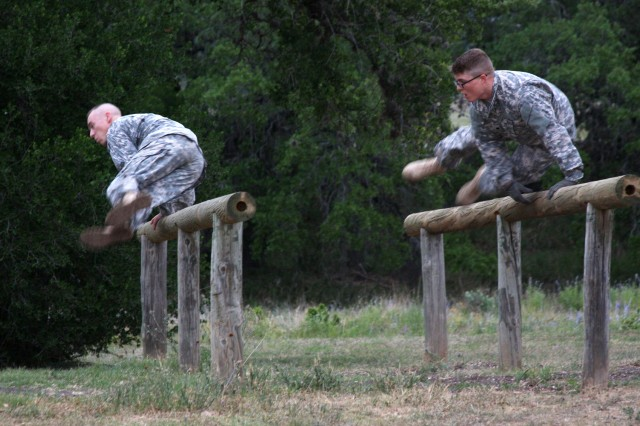 Spc. Jeromy Sisk, a military police Soldier assigned to the U.S. Army Garrison Ansbach Provost Marshal's Office, leaps over an obstacle May 6 during the U.S. Army Installation Management Command Best Warrior Competition held May 5 through 9 at Joint Base San Antonio-Camp Bullis, Texas. Sisk, who took third place in the competition, is slated to compete again at the U.S. Army Europe level in September.