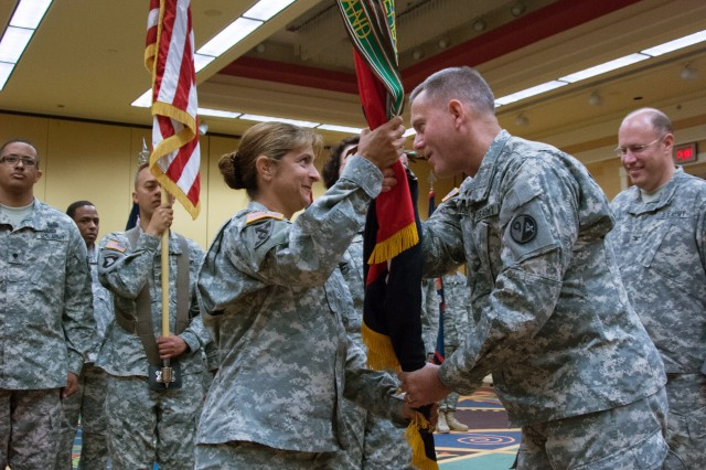 Brig. Gen. Steven W. Ainsworth, commander 94th Training Division (Force Sustainment) passes the brigade colors to incoming commander Col. Kris A. Belanger during the 4th Brigade (PS), 94th Training Division Change of Command Ceremony, Atlanta Ga. July 13, 2014. The 4th Brigade (PS) is one of five brigades subordinate to, 94th TD (FS), one of three divisions subordinate to the 80th TC, the third largest command organization in the U.S. Army Reserve. The other two divisions are the 102d Training Division, Fort Leonard Wood, Mo., and the 100th Training Division, Fort Knox, Ky.