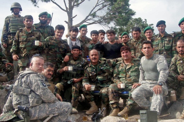 """Front, far left: Then-Lt. Col. Stephen J. Lutsky, commander 1st Squadron, 33rd Cavalry, 3rd Brigade Combat Team """"Rakkasans,"""" of the 101st Airborne Division (Assault), from Fort Campbell, Ky., takes a break with a group of soldiers from the Afghanistan National Army, during his unit's support of Operation Enduring Freedom 2010. Lutsky and his unit are featured in the recently released film, """"The Hornet's Nest,"""" which details the lives of Soldiers in one of the most violent parts of Afghanistan."""