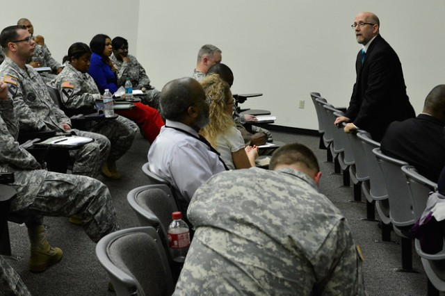 Russell Strand, chief, Behavioral Sciences Education & Training Division, U.S, Army Military Police School, who regularly instructs  Sexual Harassment/Assault Response and Prevention courses, speaks to Soldiers and civilians during training at the SHARP Academy at Fort Belvoir, February 2014.