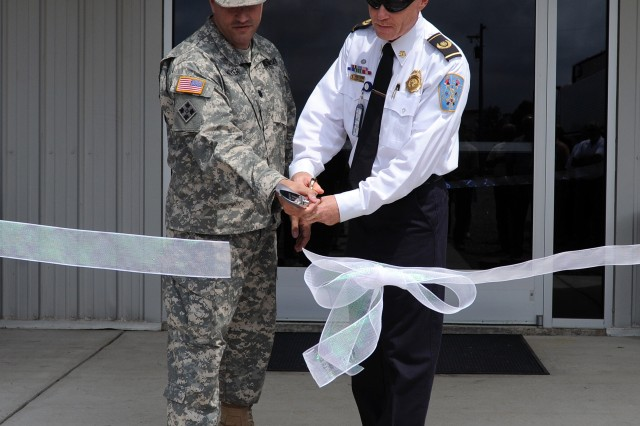 U.S. Army Garrison Fort A.P. Hill commander Lt. Col. David A. Meyer (left) and Fire Chief Daniel C. Glembot cut the ribbon on Fire Station 9. The new station is the third on the installation.