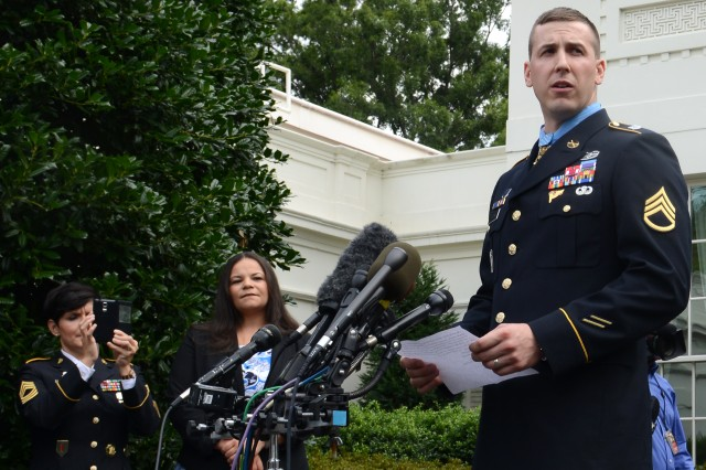 Former Staff Sgt. Ryan Pitts speaks to the media at the White House after he received the Medal of Honor, in Washington, D.C., July 21, 2014.