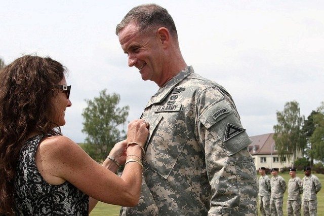 Cynthia Piatt, Maj. Gen. Walter E. Piatt's wife, puts two-star rank on his uniform.