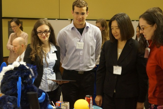 Dr. Jessie Chen from the U.S. Army Research Laboratory Human Research and Engineering Directorate in Orlando, Fla., recently spoke to leading researchers in emotion science and social robotics with DOD scientific leaders and Yale University students in the area of intelligent autonomous systems. Here, the students from Yale's Social Robotics Lab were demonstrating robots and explaining their studies to Chen. (Photo courtesy of Yale University)