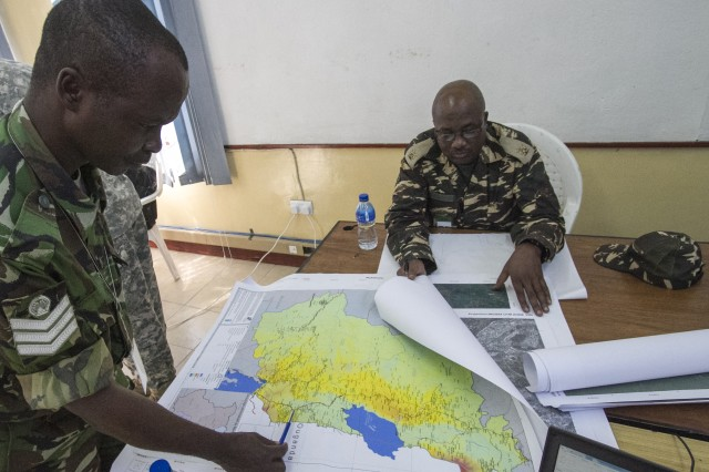 Salima, Malawi—Staff Sgt. Simon Mdlovu, U6 cell, communications noncommissioned officer, Umbutfo Swaziland Defence Force (left), and Maj. Fikameni Paulus, U6 cell, communications officer, Namibia Army, perform mission analysis during the first week of Southern Accord 14. July 18. SA 14 is a key element in a broader series of military-to-military activities to demonstrate the strong partnership between the U.S. and regional/national African partners, and all of the participating militaries.