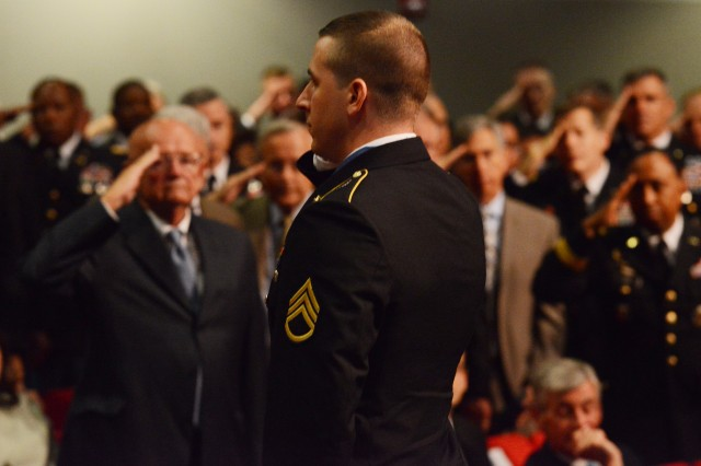 Former Staff Sgt. Ryan M. Pitts, Medal of Honor recipient, returns a salute during his induction into the Hall of Heroes during a Pentagon ceremony, July 22, 2014.