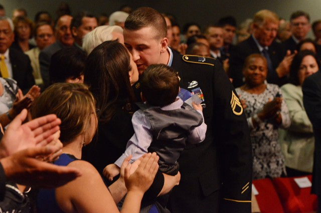 Former Staff Sgt. Ryan M. Pitts, Medal of Honor recipient, shares a moment with his wife Amy during his induction into the Hall of Heroes in a Pentagon ceremony, July 22, 2014.