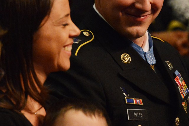 Former Staff Sgt. Ryan M. Pitts, Medal of Honor recipient, shares a moment with his wife Amy and son Lucas, during his induction into the Hall of Heroes in a Pentagon ceremony, July 22, 2014.