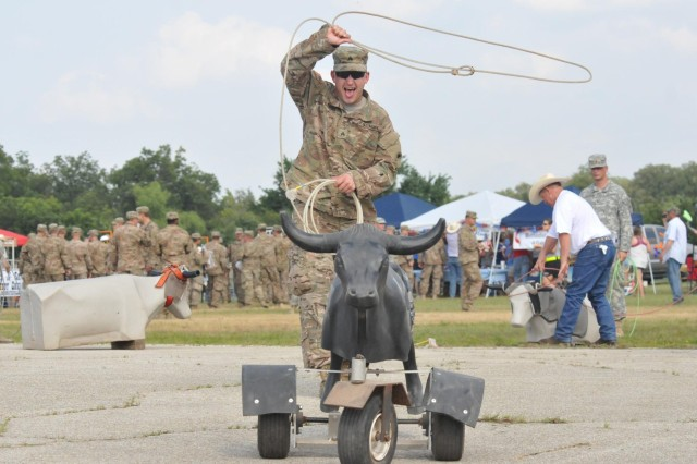 """Sgt. Travis Knedel, Delta Company, 2nd Battalion, 162nd Infantry Regiment from Vancouver, Washington, attempts to rope a bull at the """"Salute to Warrior Citizens"""" event Sunday on North Fort Hood. The community of Gatesville, Texas saluted over 1,000 mobilizing Soldiers."""